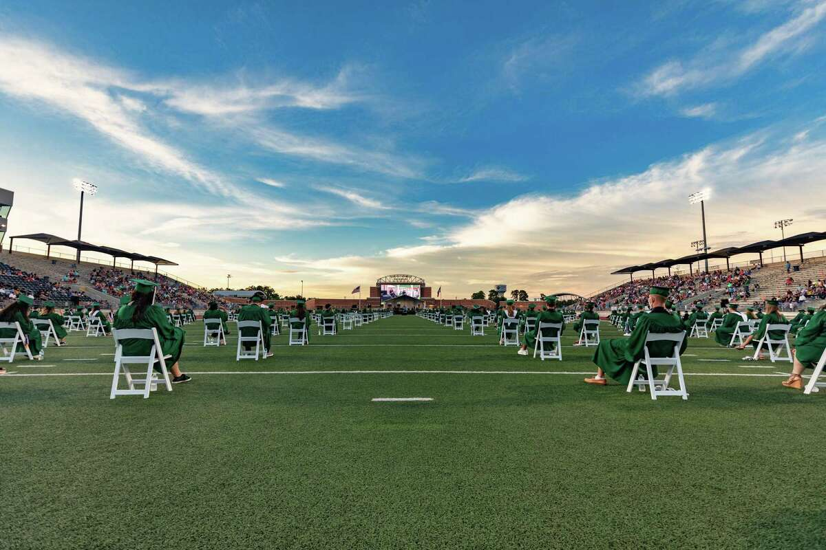 Kingwood Park High School students dressed in their forest green, silver and black school colors filled the football field, wearing face masks and sitting in white folding chairs set out for social distancing. Kingwood Park High School graduated at Turner Stadium in 2020 due to the coronavirus pandemic for the second of five days of graduation in Humble ISD.