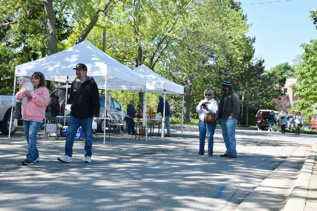 Patrons could be seen visiting vendors on the opening day of the Manistee Farmers Market on May 29.