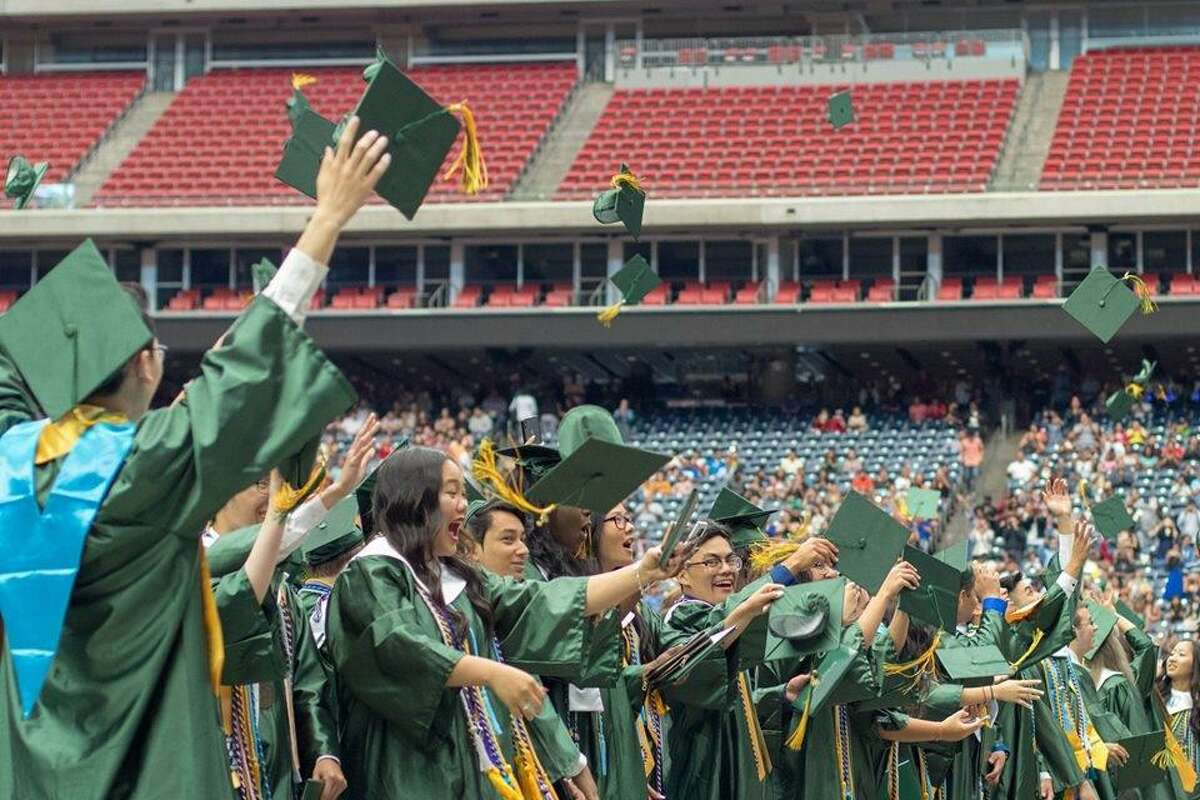 In this photo from 2019, Klein Forest High School students celebrate their graduation ceremony.