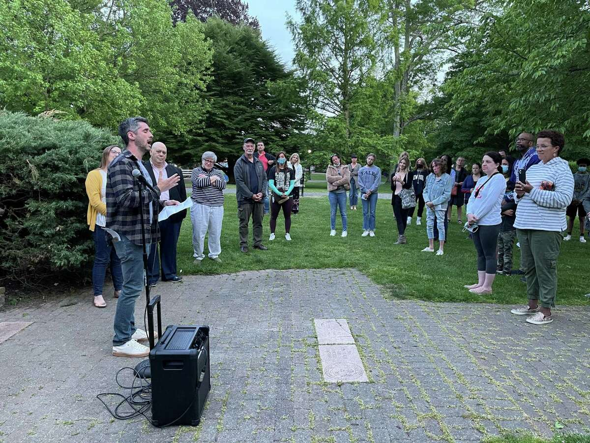 """Ridgefield Allies board member Bryan Perri, left, performs a rendition of """"How Can I Keep From Singing"""" during the organization's twilight vigil, which was held on the one-year anniversary of George Floyd's death."""