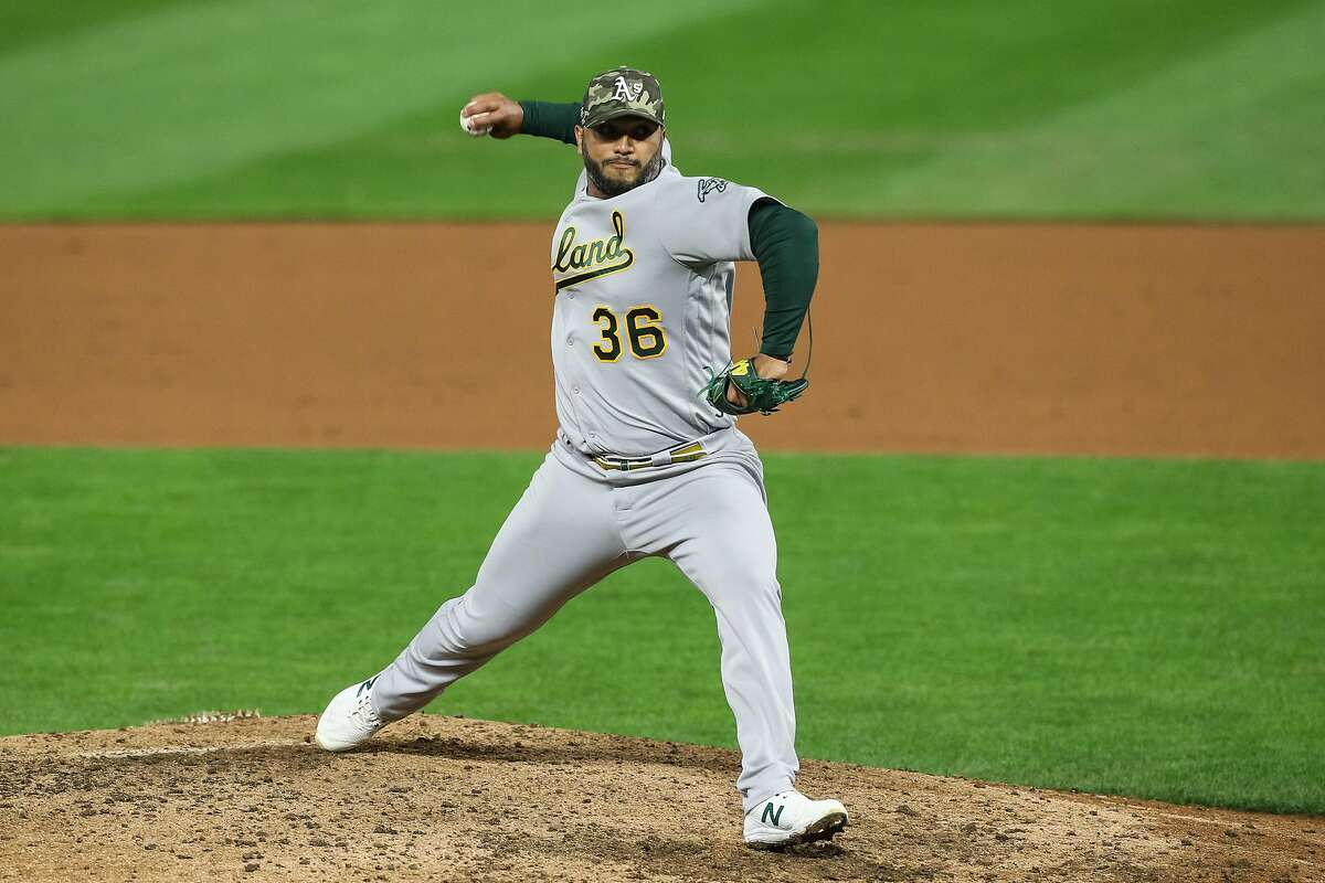 MINNEAPOLIS, MN - MAY 14: Yusmeiro Petit #36 of the Oakland Athletics delivers a pitch against the Minnesota Twins in the eighth inning of the game at Target Field on May 14, 2021 in Minneapolis, Minnesota. The Athletics defeated the Twins 6-1. (Photo by David Berding/Getty Images)