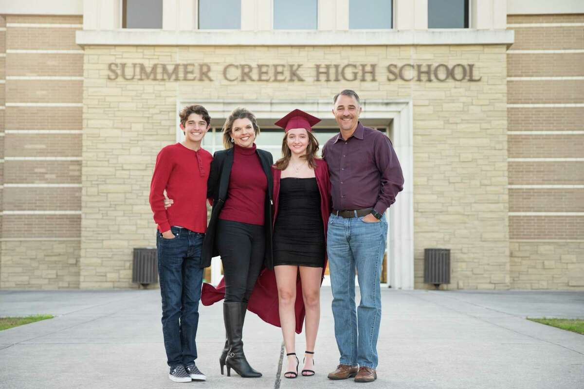 The McDonald family poses for a graduation photo in the front of Summer Creek High School. From left to right, Dominic McDonald, Angie McDonald, Summer Creek Valedictorian BreAnna McDonald and Principal Brent McDonald.