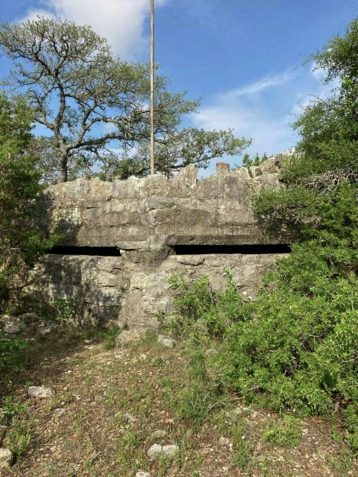 One of several, the bunker on top of Buck Hill at Camp Bullis was built for annual maneuvers between the world wars. An inscription dedicates it to the Second Field Artillery Brigade, one of the units that engaged in