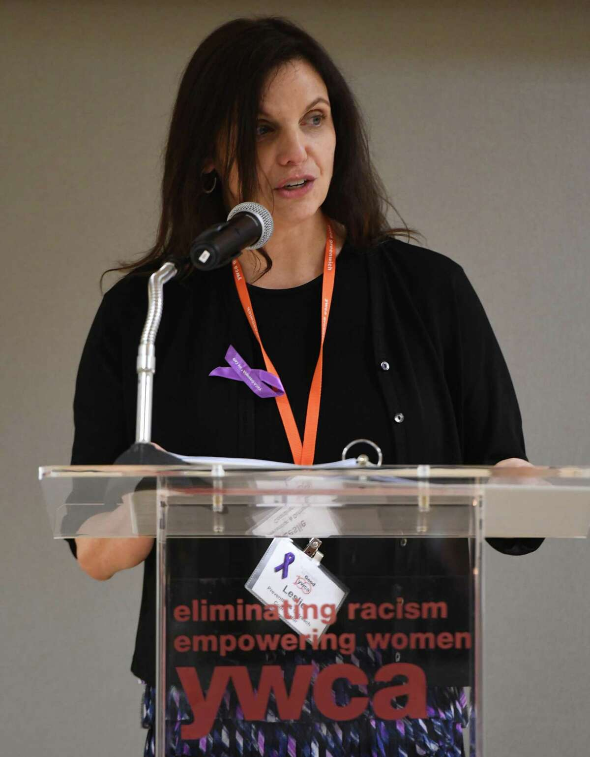 Domestic Abuse Services Prevention and Outreach Coordinator LEslie Coplin speaks at the annual Domestic Violence Candlelight Vigil and Art Show Reception at the YWCA in Greenwich, Conn. Thursday, Oct. 10, 2019.