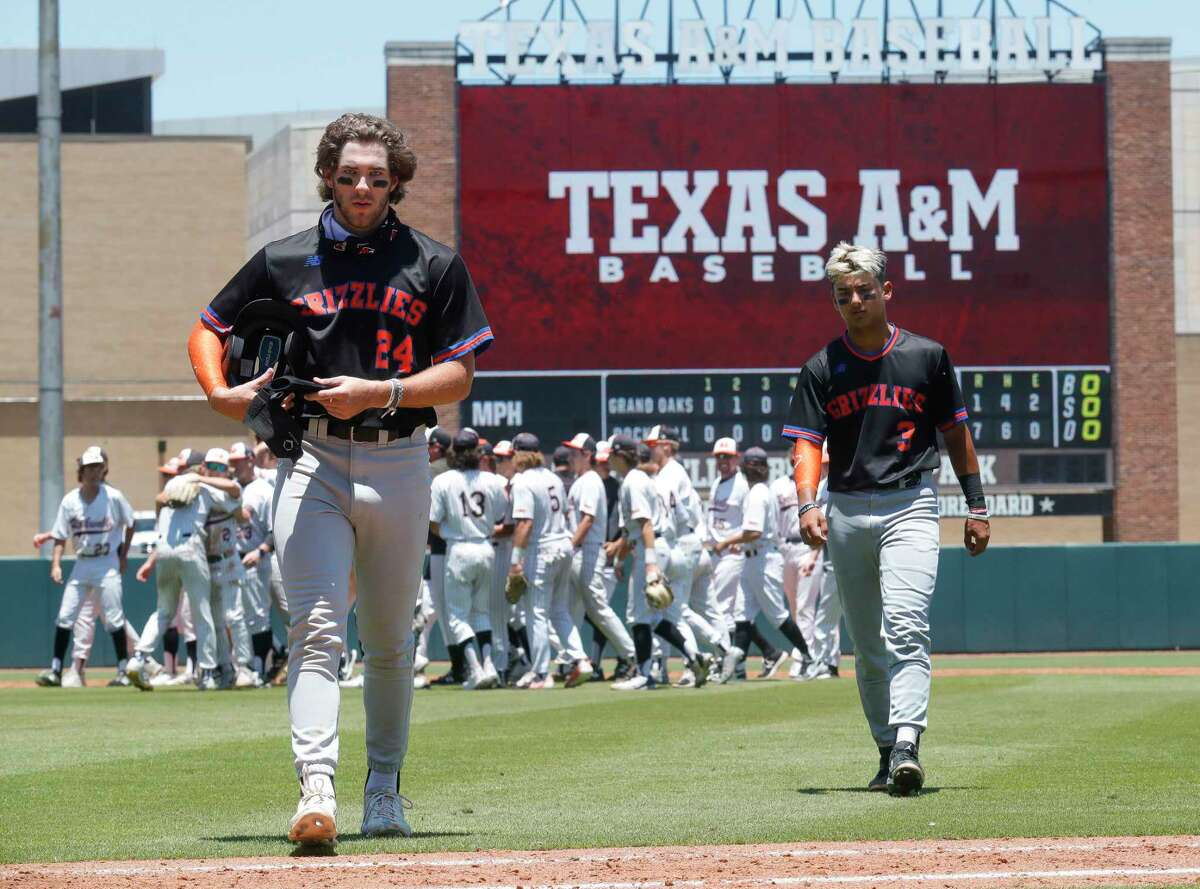 Grand Oaks' Shane Martin, left, and Larry Drake walk off the field after losing to 7-1 in Game 2 of their Region III-5A semifinal series against Rockwall at Blue Bell Park, Saturday, May 29, 2021, in College Station.