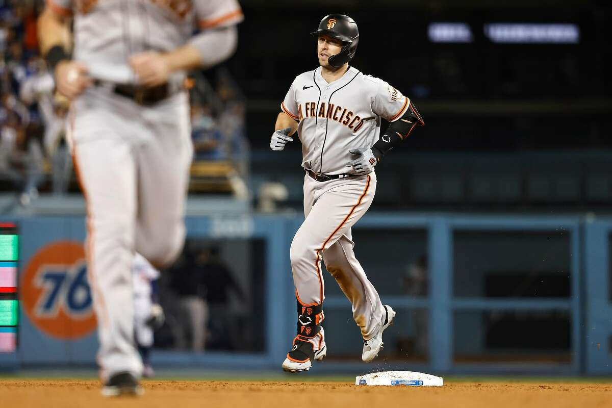 LOS ANGELES, CALIFORNIA - MAY 28: Buster Posey #28 of the San Francisco Giants rounds the bases after hitting a three-run home run against the Los Angeles Dodgers during the eighth inning at Dodger Stadium on May 28, 2021 in Los Angeles, California. LaMonte Wade Jr. and Mike Yastrzemski scored. (Photo by Michael Owens/Getty Images)