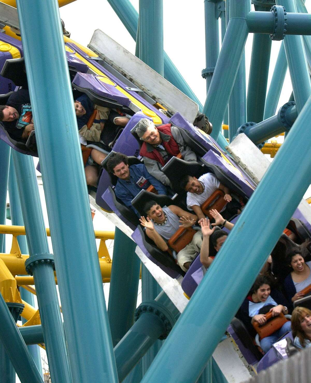 People ride the Poltergeist roller coaster in this 2003 photo.
