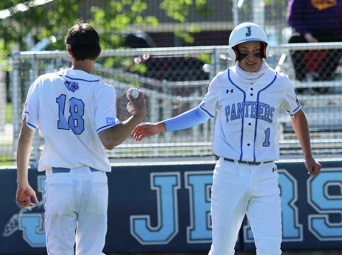 Jersey's Ian Sullivan (right) is greeted by teammate Brayden Heafner after scoring a run in a win over CM on May 12 at Ken Schell Field in Jerseyville. On Friday back at home, both Sullivan and Heafner had three hits and two RBI in the second game of a doubleheader sweep of Southwestern.