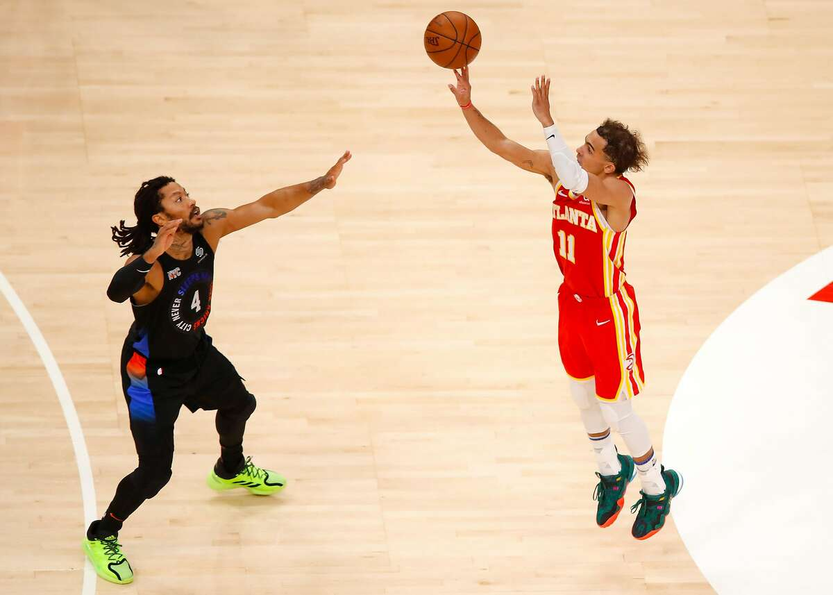 ATLANTA, GA - MAY 28: Trae Young #11 of the Atlanta Hawks shoots as Derrick Rose #4 of the New York Knicks defends in the first half during game three of the Eastern Conference Quarterfinals at State Farm Arena on May 28, 2021 in Atlanta, Georgia. NOTE TO USER: User expressly acknowledges and agrees that, by downloading and/or using this photograph, user is consenting to the terms and conditions of the Getty Images License Agreement. (Photo by Todd Kirkland/Getty Images)