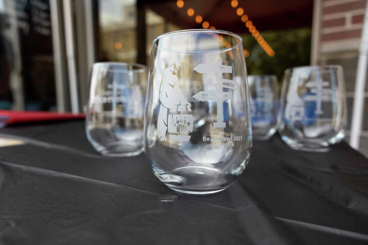 Custom wine glasses are seen during the inaugural Bear Crawl at The Ferm, Saturday, May 29, 2021, in downtown Conroe. The event was sponsored by Office Evolution and funds raised will be used to secure a property for a Bear and Exotic Animal Rescue Sanctuary.