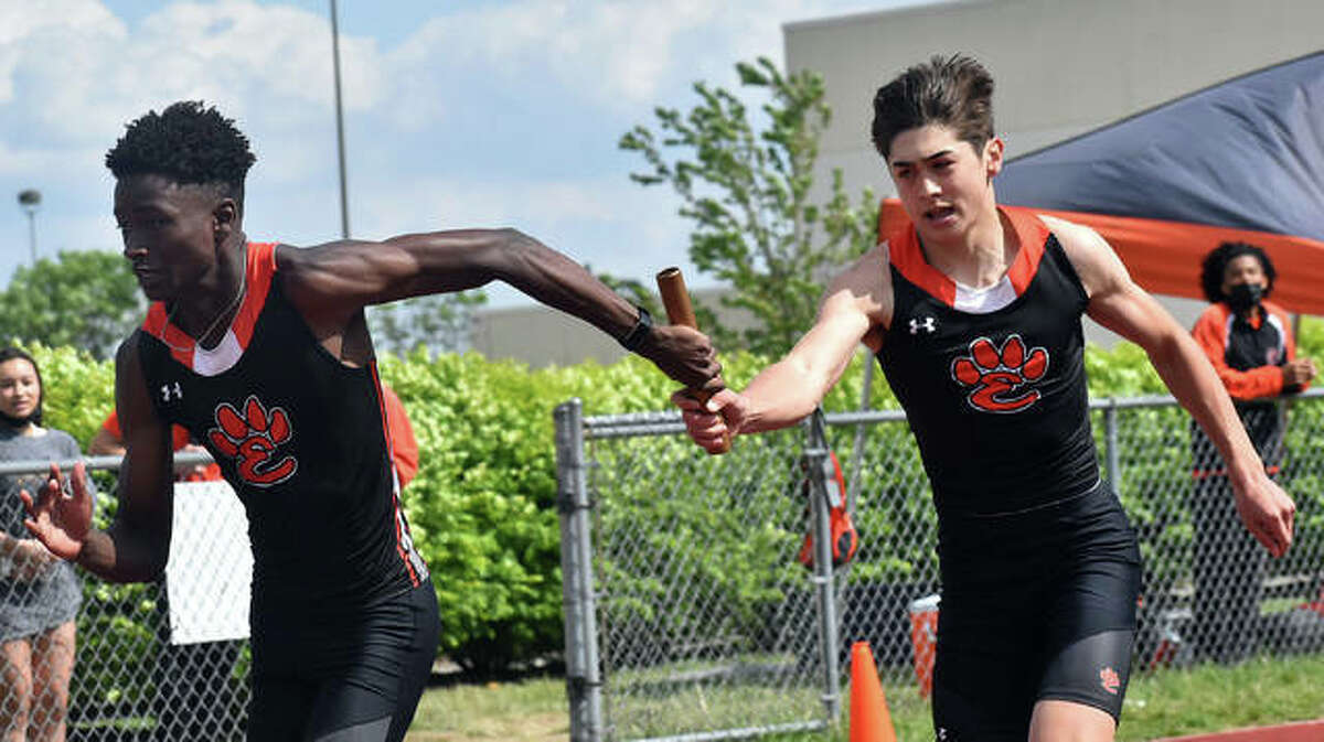 In this file photo, Carson Bateman takes the baton from Grant Matarelli in a relay event at the Winston Brown Invitational at Edwardsville.