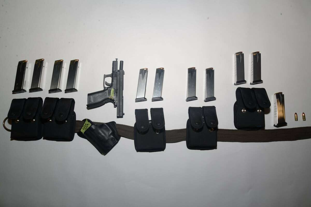 This undated photo provided by the Santa Clara County Sheriff's Office shows guns and ammunition magazines found at the residence of Samuel Cassidy, the suspect in the Wednesday May 26, 2021 shooting at a San Jose rail station. (Santa Clara County Sheriff's Office via AP)