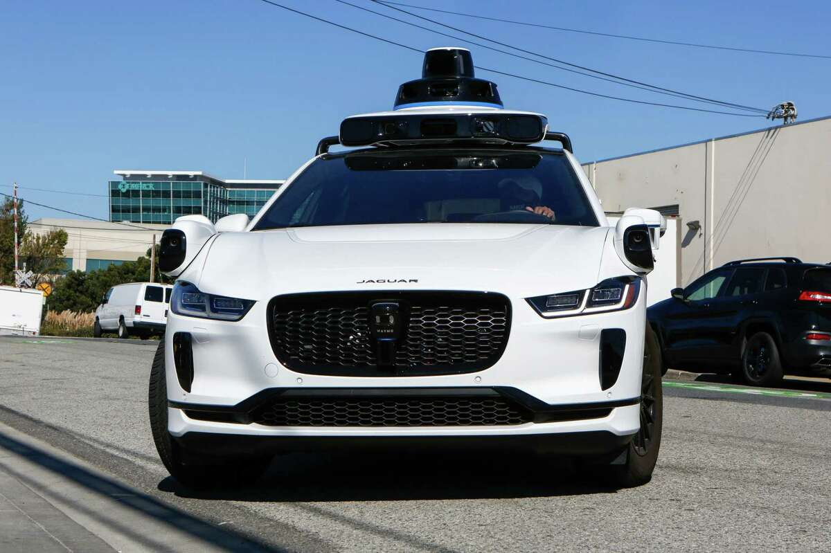 Waymo Jaguar I-Pace car arrives at its temporary location in 2020 in South San Francisco. Waymo is launching a pilot program in San Francisco using autonomous vehicles.