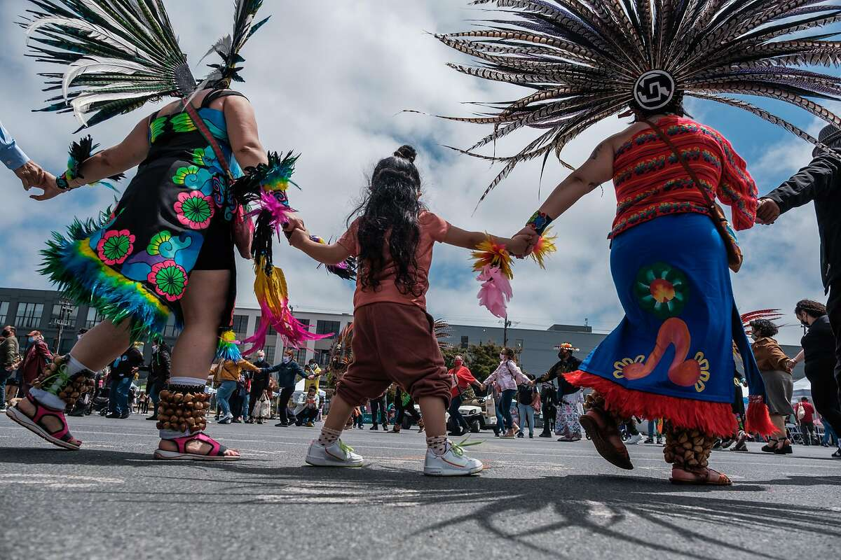 Traditional dancers and visitors perform a friendship dance to kick off the beginning of Carnaval celebrations in San Francisco on Saturday.