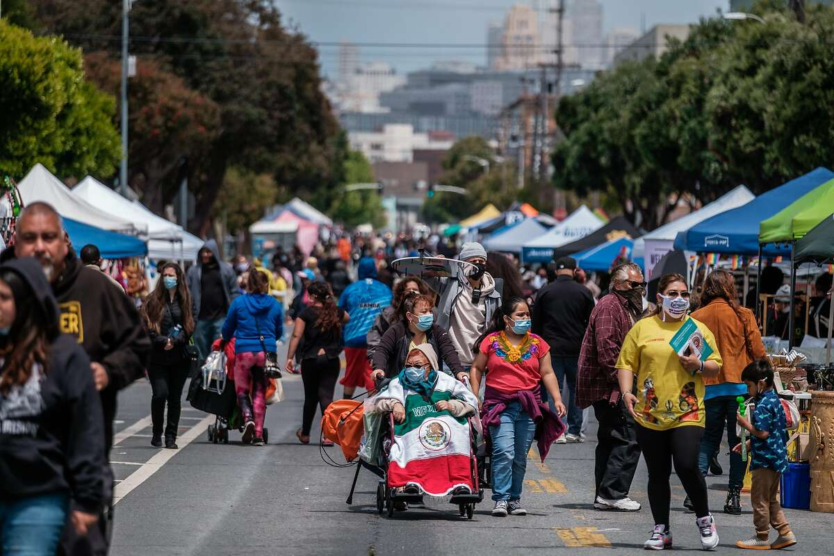 Visitors crowd Harrison Street as Carnaval celebrations began in San Francisco on Saturday. For the second year, Carnaval San Francisco held a community resource fair in place of its traditional parade and festival.