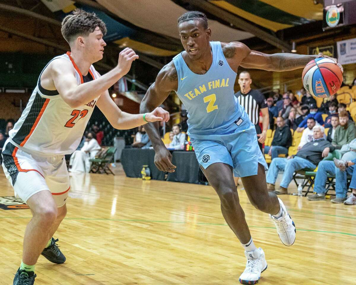 Hudson Falls native and City Rocks player Jonathan Beagle, shown guarding Team Final's Jalen Duren at the GymRat Challenge at Washington Avenue Armory in May, has committed to play for UAlbany basketball in 2022-23. (Jim Franco/Special to the Times Union)