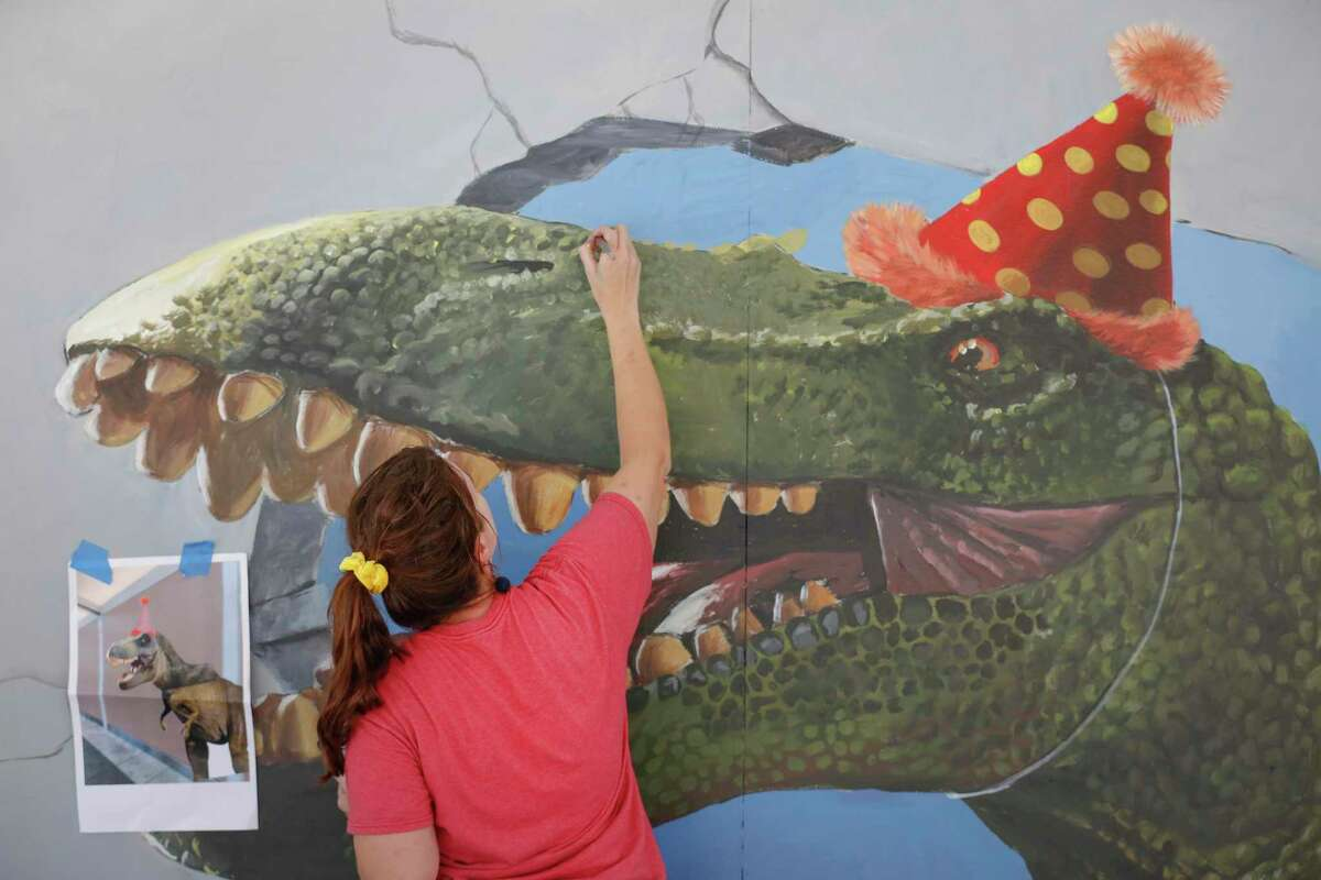 Artist Naomi Haverland paints a 3D mural as other dynamic new murals were created simultaneously during the Big Walls Big Dreams Refresh festival Saturday, May 29, 2021, in Houston.