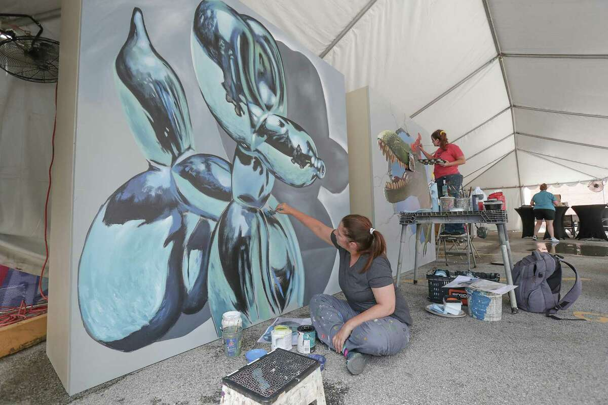 Artists Anat Ronen (l-r) and Naomi Haverland paint 3D murals as other dynamic new murals were created simultaneously during the Big Walls Big Dreams Refresh festival Saturday, May 29, 2021, in Houston.
