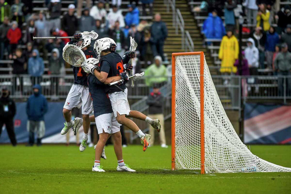 Virginia players celebrate after they defeated North Carolina in the semifinals of the NCAA Division I tournament at Rentschler Field Saturday in East Hartford.
