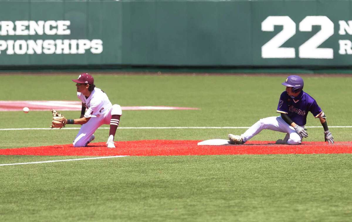 Armando Rocha #7 of Jersey Village slides to safety on second base before Pearland second baseman Logan Scott (16) catches the ball during the fourth inning of the Region III-6As semifinal series at Darryl & Lori Schroeder Park, Saturday, May 29, 2021, in Houston.