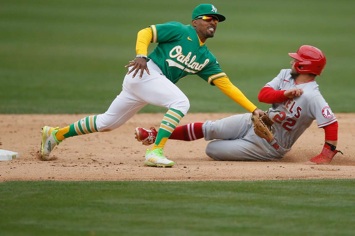 Los Angeles Angels third baseman David Fletcher (22) steals second base against Oakland Athletics second baseman Tony Kemp (5) in the ninth inning during an MLB game at RingCentral Coliseum, Saturday, May 29, 2021, in Oakland, Calif.