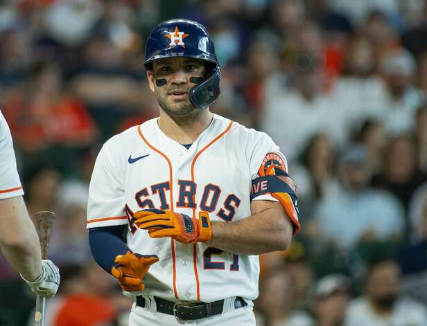 Houston Astros second baseman Jose Altuve (27) reacts as he is hit by a pitch during the fifth inning of an MLB game between the Houston Astros and San Diego Padres on Saturday, May 29, 2021, at Minute Maid Park in Houston. Altuve would go onto score on a hit by Houston Astros left fielder Kyle Tucker (30). Photo: Mark Mulligan/Staff Photographer / © 2021 Mark Mulligan / Houston Chronicle