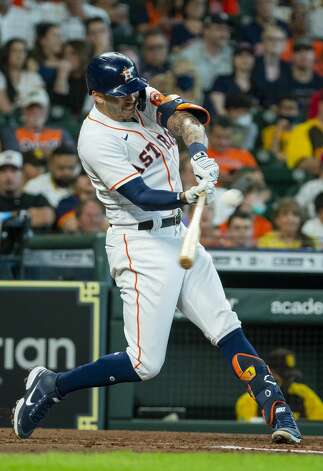 Houston Astros shortstop Carlos Correa (1) hits a two-run home run that drives in Houston Astros right fielder Chas McCormick (20) during the fourth inning of an MLB game between the Houston Astros and San Diego Padres on Saturday, May 29, 2021, at Minute Maid Park in Houston. Photo: Mark Mulligan/Staff Photographer / © 2021 Mark Mulligan / Houston Chronicle