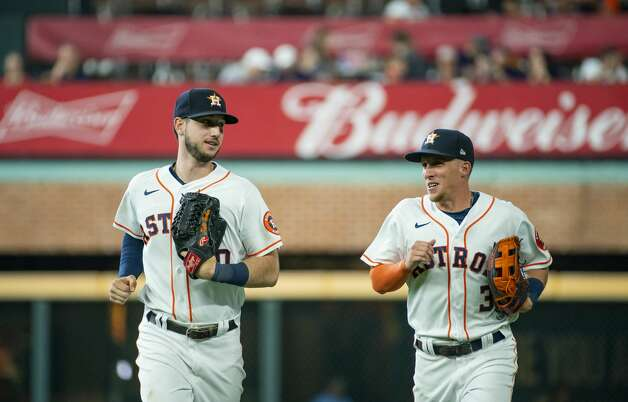 Houston Astros left fielder Kyle Tucker (30) and Houston Astros center fielder Myles Straw (3) run off the field at the end of the top of the third inning after Straw caught a fly out from San Diego Padres third baseman Manny Machado (13) during an MLB game between the Houston Astros and San Diego Padres on Saturday, May 29, 2021, at Minute Maid Park in Houston. Photo: Mark Mulligan/Staff Photographer / © 2021 Mark Mulligan / Houston Chronicle