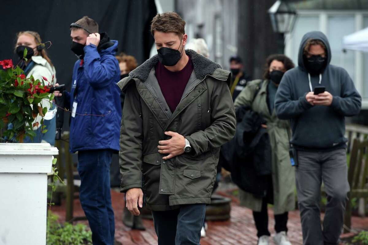 """Actor Justin Hartley (""""This is Us"""") is pictured here walks to the Griswold Inn Store for the filming of a scene for the Netflix movie based on the novel, """"The Noel Diary,"""" in Essex on May 29. Filming also took place in Madison. Read more."""