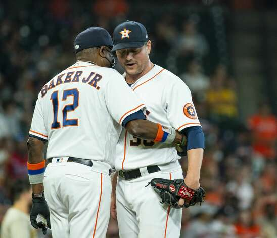 Houston Astros manager Dusty Baker Jr. (12) pulls Houston Astros relief pitcher Joe Smith (38) from the game during the eighth inning of an MLB game between the Houston Astros and San Diego Padres on Saturday, May 29, 2021, at Minute Maid Park in Houston. Photo: Mark Mulligan/Staff Photographer / © 2021 Mark Mulligan / Houston Chronicle