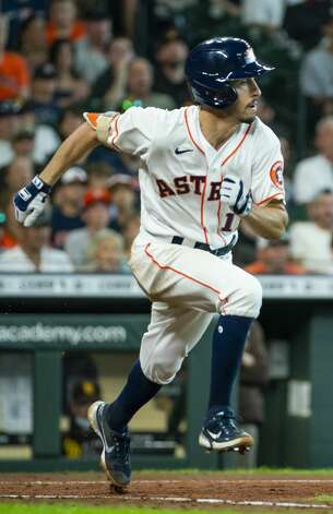 Houston Astros catcher Garrett Stubbs runs to first on a sacrifice bunt that drove in Houston Astros first baseman Taylor Jones (28) during the sixth inning of an MLB game between the Houston Astros and San Diego Padres on Saturday, May 29, 2021, at Minute Maid Park in Houston. Photo: Mark Mulligan/Staff Photographer / © 2021 Mark Mulligan / Houston Chronicle