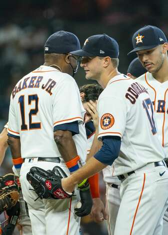 Houston Astros starting pitcher Jake Odorizzi (17) is taken out of the game by Houston Astros manager Dusty Baker Jr. (12) during the sixth inning of an MLB game between the Houston Astros and San Diego Padres on Saturday, May 29, 2021, at Minute Maid Park in Houston. Photo: Mark Mulligan/Staff Photographer / © 2021 Mark Mulligan / Houston Chronicle