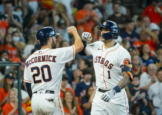 Houston Astros shortstop Carlos Correa (1) celebrates after hitting a two-run home run that drives in Houston Astros right fielder Chas McCormick (20) during the fourth inning of an MLB game between the Houston Astros and San Diego Padres on Saturday, May 29, 2021, at Minute Maid Park in Houston. Photo: Mark Mulligan/Staff Photographer / © 2021 Mark Mulligan / Houston Chronicle