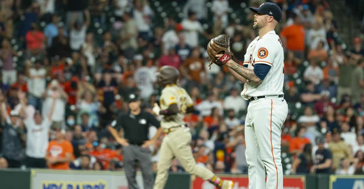 Houston Astros relief pitcher Ryan Pressly (55) stands on the mound as San Diego Padres shortstop Fernando Tatis Jr. (23) runs the basses after hitting a three-run home run to tie the game 6-6 during the ninth inning of an MLB game between the Houston Astros and San Diego Padres on Saturday, May 29, 2021, at Minute Maid Park in Houston.