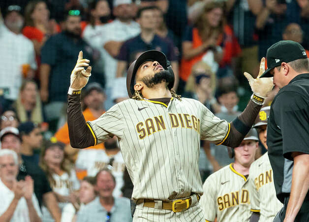 San Diego Padres shortstop Fernando Tatis Jr. (23) celebrates hitting a three-run home run to tie the game 6-6 during the ninth inning of an MLB game between the Houston Astros and San Diego Padres on Saturday, May 29, 2021, at Minute Maid Park in Houston. Photo: Mark Mulligan/Staff Photographer / © 2021 Mark Mulligan / Houston Chronicle