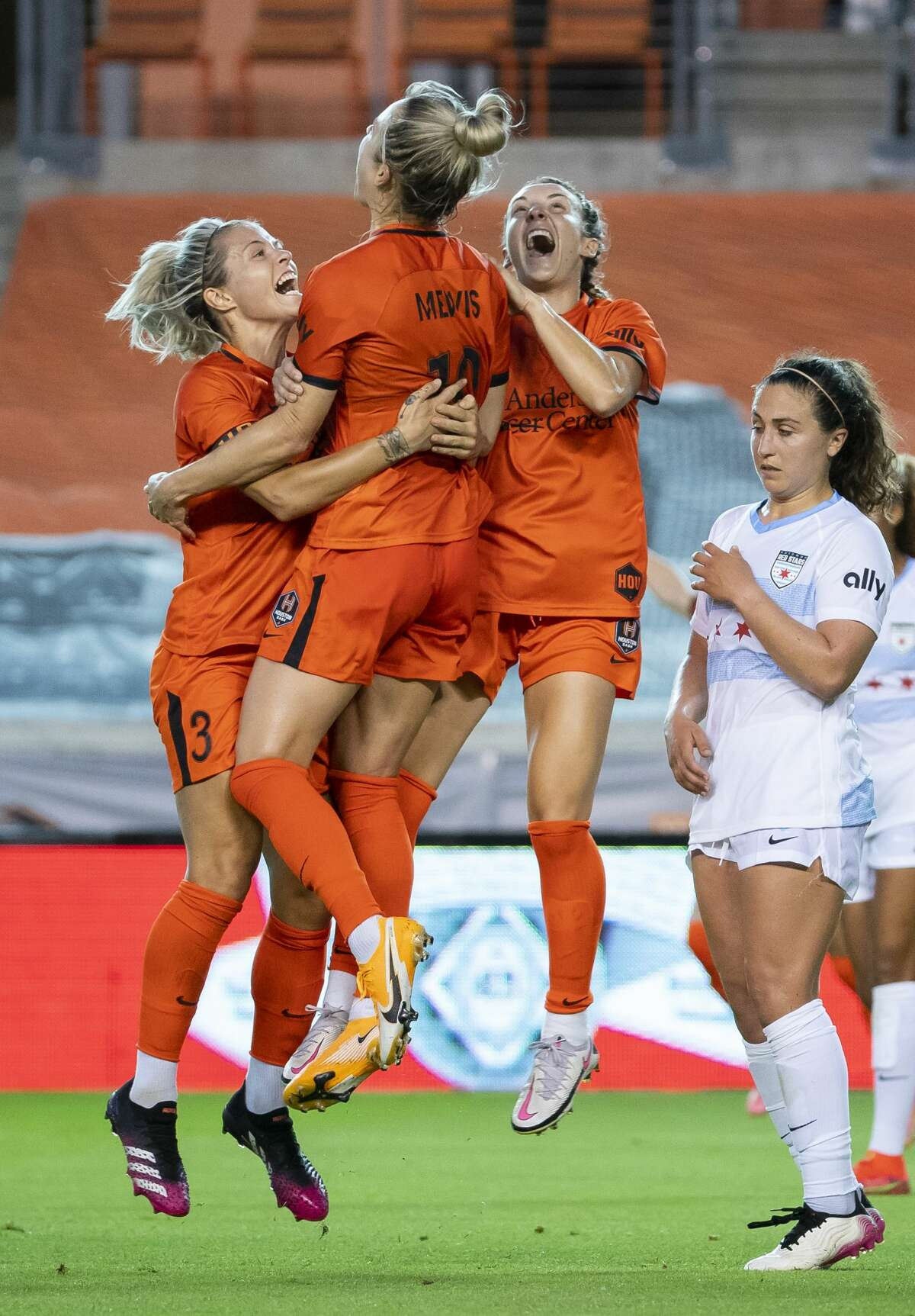 Houston Dash midfielder Kristie Mewis (19), center, celebrates with Houston Dash forward Rachel Daly (3), left, and Houston Dash midfielder Gabby Seiler (5), right, celebrate Mewis's second half goal that gave the Dash a 2-1 lead during a game between the Houston Dash and the Chicago Red Stars on Saturday, May 29, 2021, at BBVA Stadium in Houston.