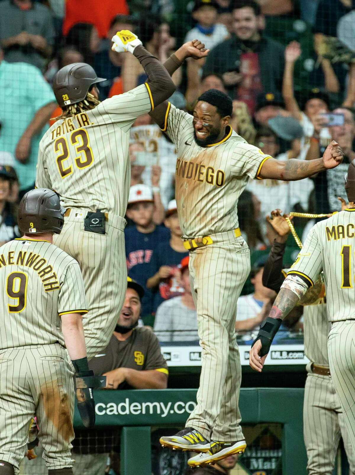 Padres shortstop Fernando Tatís Jr. (23) celebrates hitting a three-run home run in the ninth inning to tie the game 6-6. For the second day in a row, the Astros lost in extra innings.