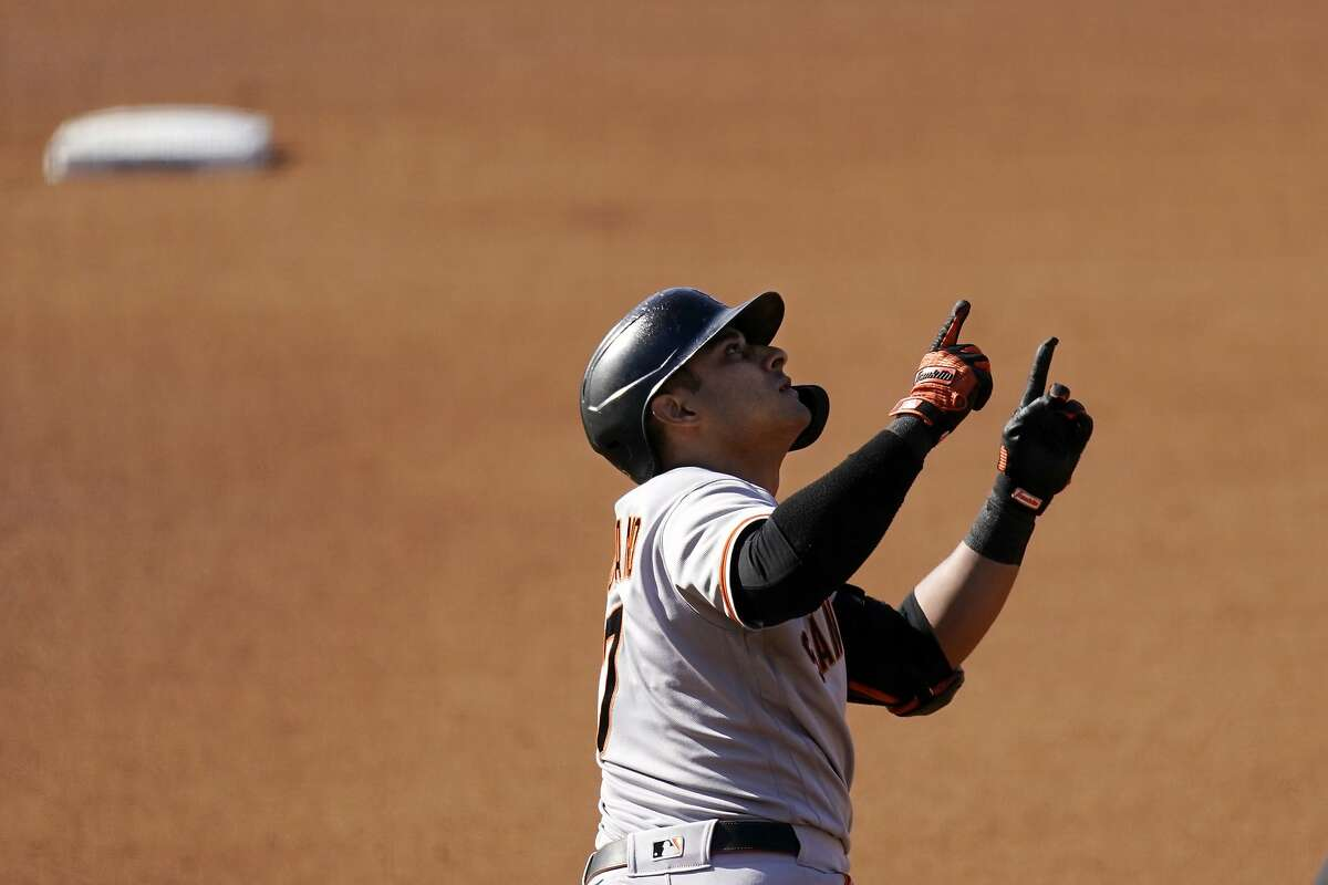 San Francisco Giants' Donovan Solano celebrates as he rounds first after hitting a two-run home run during the third inning of a baseball game against the Los Angeles Dodgers Saturday, May 29, 2021, in Los Angeles. (AP Photo/Mark J. Terrill)