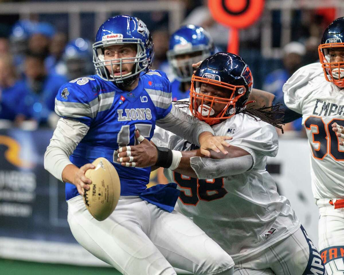 Albany Empire defender Rashaad Miller drags down Columbus Lions quarterback Mason Espinosa in their game on May 29, 2021. Albany is one sack off the league lead.