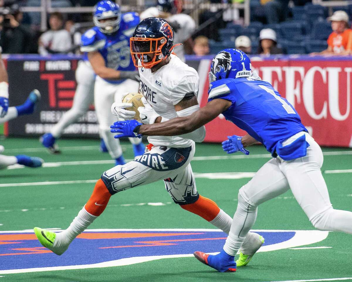 Albany Empire receiver Darius Prince picks up yardage in front of Columbus Lions defender Marvin Ross during the opener of the National Arena League football season at the Times Union Center in Albany, NY, on Saturday, May 29, 2021 (Jim Franco/Special to the Times Union)
