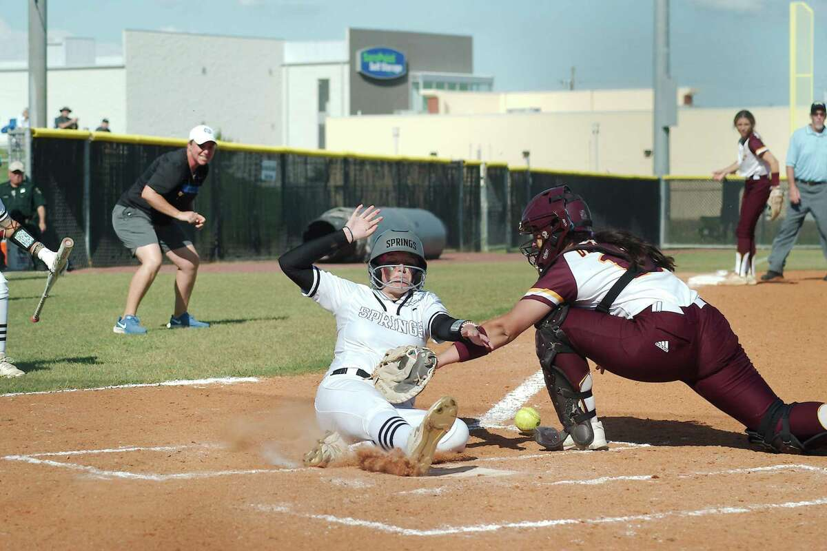 Deer Park's Erin Perez (17) loses the ball as Clear Springs' Lilly Hardy (11) crosses home plate to score the go-ahead run against Deer Park Saturday, May 29 at Shadow Creek High School.