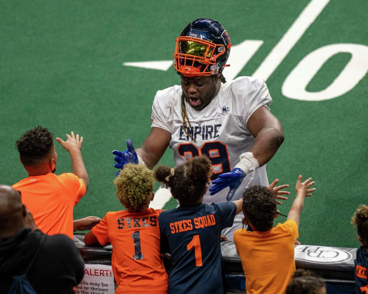 Albany Empire fullback Derrick Ross has some fun with the fans during the opener of the National Arena League football season against the Columbus Lions at Times Union Center. He left the team under considerably less jovial circumstances.