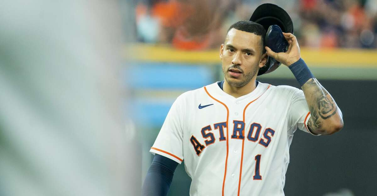 Houston Astros shortstop Carlos Correa (1) reacts after being left stranded on second base to end the second inning during an MLB game between the Houston Astros and San Diego Padres on Saturday, May 29, 2021, at Minute Maid Park in Houston.