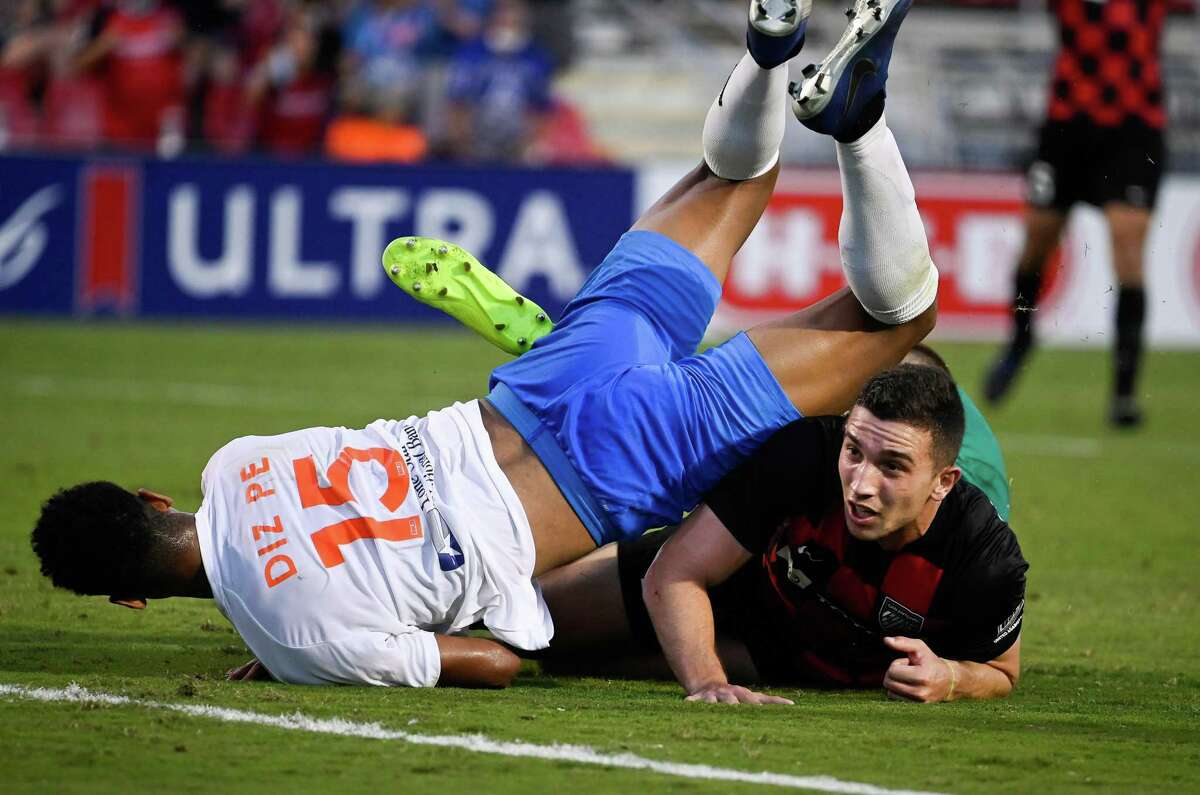 San Antonio FC's Nathan Fogaca, right, is tangled up with Rio Grande Valley FC's Adrian Diz Pe during their match Saturday, May 29, 2021, at Toyota Field.