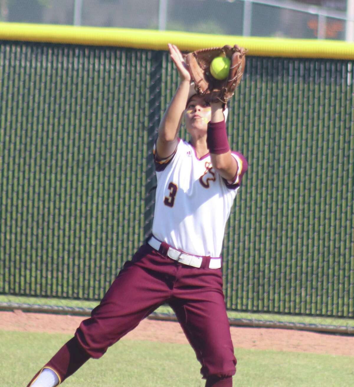 Linda Gobea gloves this line drive in right field during second-inning action of Game 2 Saturday.