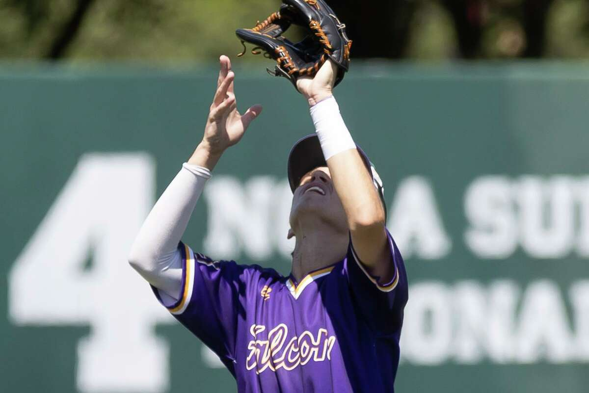 Jersey Village third baseman Toby Deluca (18) catches a flyball during the third inning of the Region III-6As semifinal series against Pearland at Darryl & Lori Schroeder Park, Saturday, May 29, 2021, in Houston.