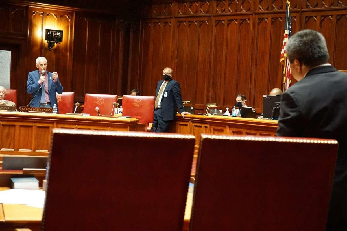 Sen. Norm Needleman debates the zoning bill with Sen. Tony Hwang (foreground)