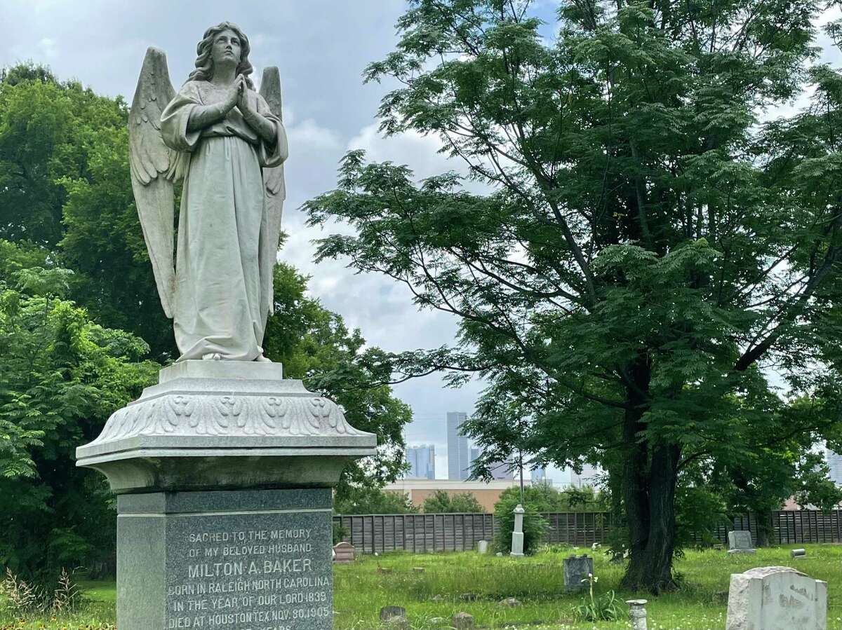 The majestic angel standing over the grave of Milton Baker has become the unofficial symbol of Olivewood Cemetery.