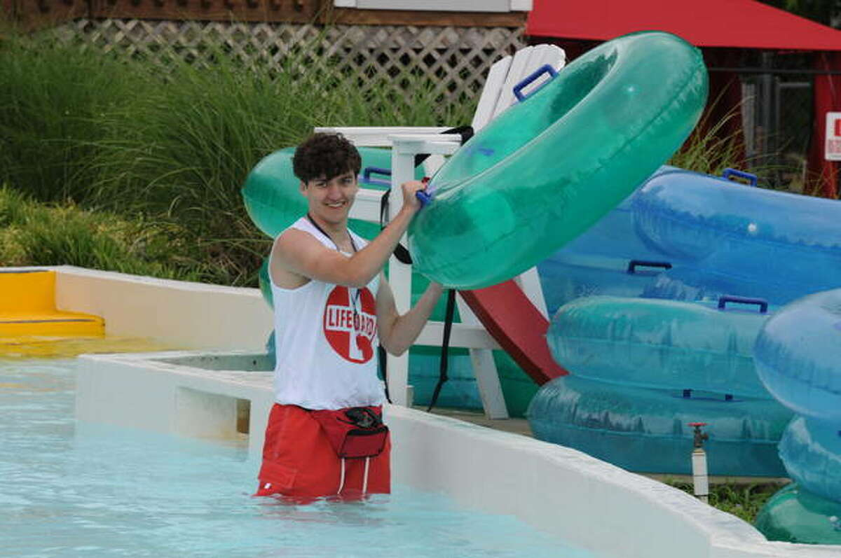A Raging Rivers employee stores floats after the Grafton waterpark closed early on Saturday due to unseasonably cool temperatures. The waterpark is open every day through Aug. 22 from 10 a.m. to 6 p.m.