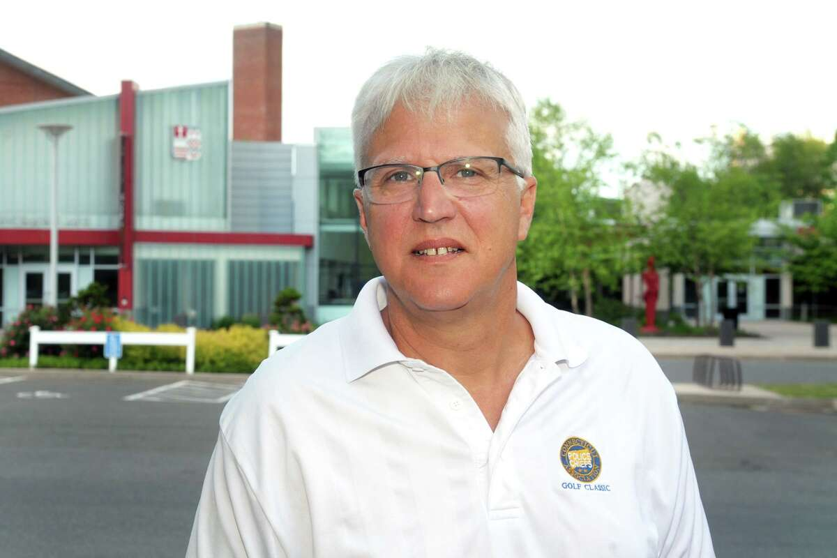 Former Stamford Assistant Police Chief Tom Wuennemann poses on the campus of Sacred Heart University, where he teaches criminal justice classes, in Fairfield, Conn. May 27, 2021. Wuennemann retired recently after 37 years on the Stamford police force.